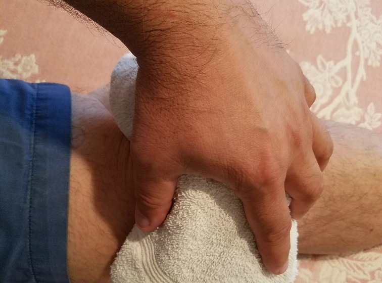 Man icing knee after an injury