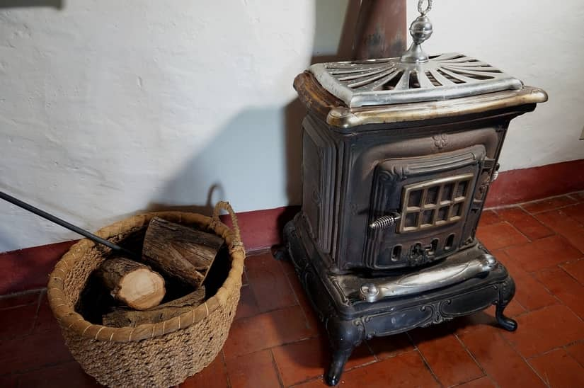wood stove and firewood for heat