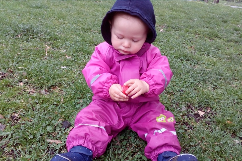 baby in a rain suit