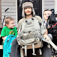 dad and sons with bug out bags